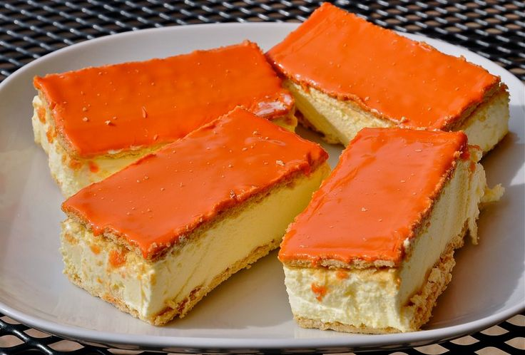 "Everything turned magically into ORANGE on Queen's (now King) Day in Holland, even the foods and drinks changed color. These delicious pastry called ""Tompouce"" (Napoleons in the US), happen to be one of my most favorite treats. I'd enjoy them in any color, really..."