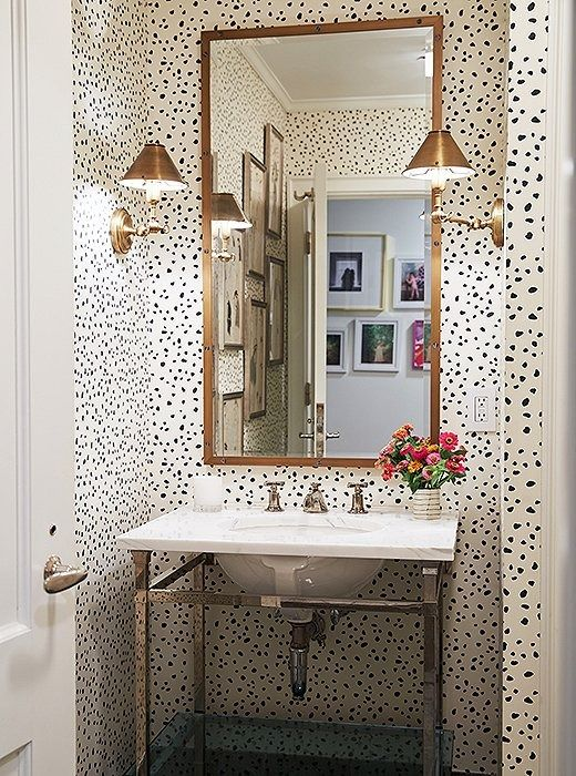 This sophisticated spotted wallpaper—a leopard-inspired print—function almost as a neutral, thanks largely to the limited palette and modest scale. It's the perfect background for accessorizing and adding character—which is key in a tiny area such as the bathroom, where you don't want to waste precious counter space.