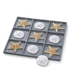 "shell tic-tac-toe décor -    Sure to invite comments, this decorative tic-tac-toe game brings a feel of the sea into your home. Beautifully crafted resin starfish and sand dollars form the x's and o's -- the set comes with 5 each, as well as a resin tray with 9 compartments made to look like weathered wood. Measures 14"" x 14"". Imported."