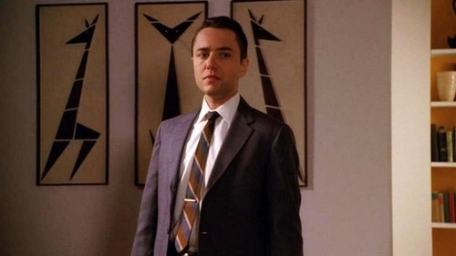 more of Pete Campbell's apartment: the giraffes and a hint of the yellow bookshelves