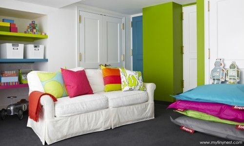 We love the idea of painting a small wall in the playroom a fun pop of color!Basements Playrooms, Colors Playrooms, Playrooms Colors, Floor Pillows, Kids Room, Tiny Nests, Colors Shelves, Plays Room, Bright Colors