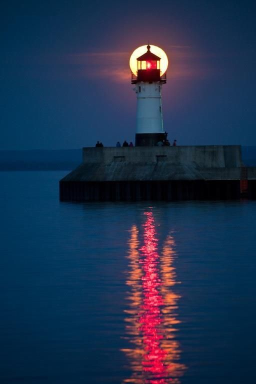 At night lights tower lighthouse on the rocks