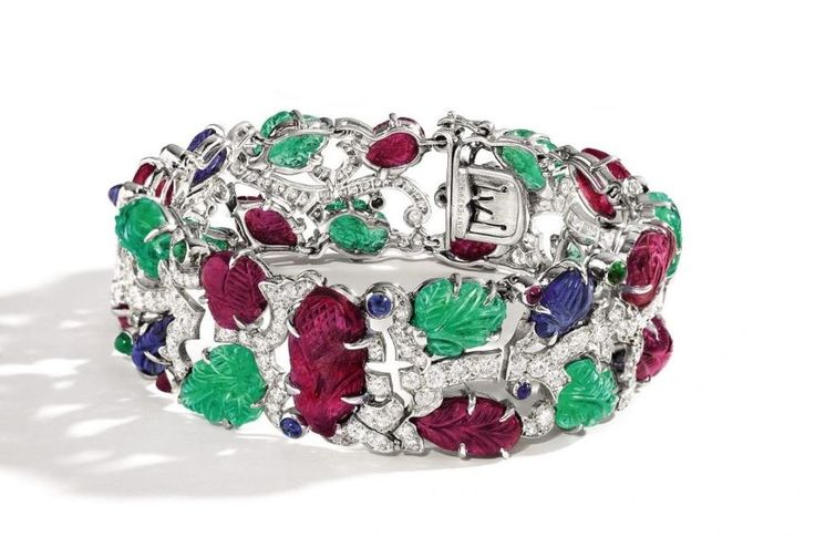 """Cartier Tutti Frutti Bracelet Highlights Sotheby's Hong Kong Auction The October 3 sale features a 13.26-carat Maniraja """"pigeon blood"""" ruby mounted on a diamond ring designed by BHAGAT, colored diamonds and gems, and signed jewels from JAR, Van Cleef & Arpels and..."""
