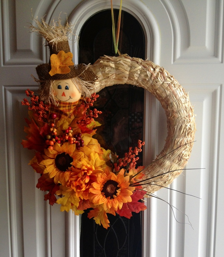 Fall wreath I made.. $3 for the hay wreath; 99cents for the scarecrow; 3 bundles of fall leaves 94cents; 3 flowers with accents $1. All purchased from Walmart at a total cost of $9!!!