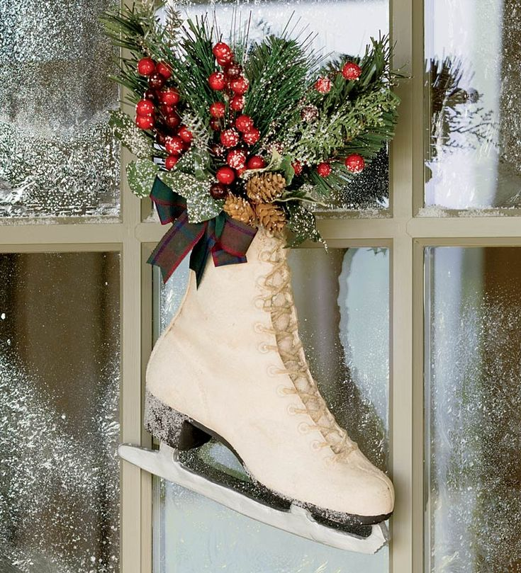 You can often find old skates at the Goodwill or kids consignment sales/stores.  Cut some holly berry branches if you have some in the yard, add bay leaves, and the branches trimmed from the bottom of the Christmas tree.  Voila!!  It will smell good, look pretty, and last long.