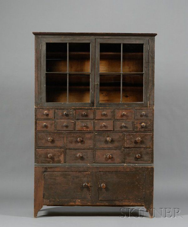 Grain-painted Glazed Twenty-Drawer Apothecary Cabinet, Massachusetts, early 19th century, in two sections, 75.25, H. x 48.5 W. x 13 D.