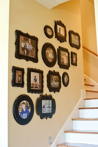 We love this neutral, staircase wall display.  | Frames via The Organic Bloom
