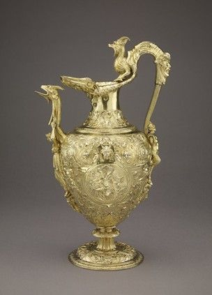 1550s Ewer; silver-gilt; embossed and chased; spout in form of goat's head supported by draped female figure standing on mask of Pan; handle a flat band rising from a figure of Pan who stands on a female mask, and terminating in a goat-like monster; oviform body with two circular medallions, Neptune and Amphitrite fully draped; body ornamented with strapwork,