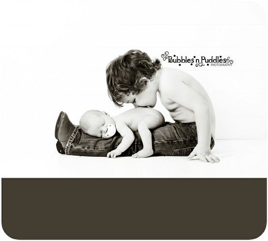 Newborn photography..baby laying opposite way so Tayden could kiss his head