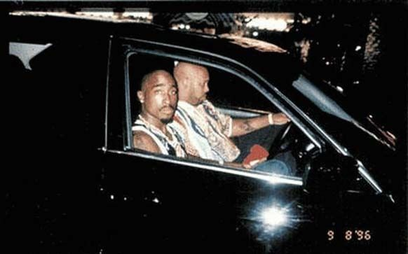 Tupac Shakur sits with his manager Suge Knight before he was shot to death in a drive-by on September 13, 1996.