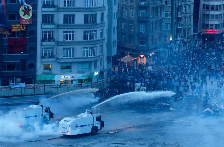 Protesters run as riot police fire teargas and water cannons in Taksim Square in Istanbul on June 11, 2013. (Osman Orsal/Reuters)