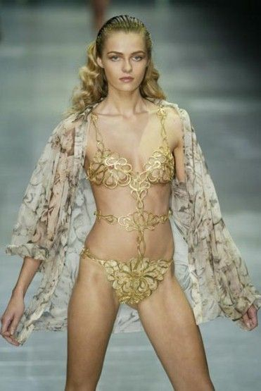 Risqué: McQueen liked to shock with flesh-flashing designs. This gold cut-out bikini is from spring/summer 2006.