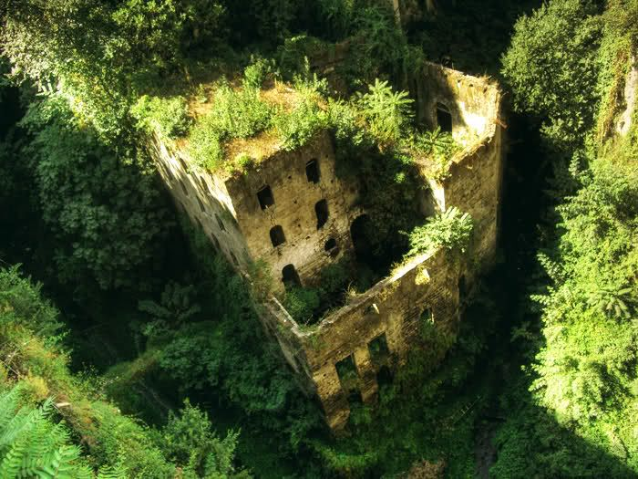 This is an abandoned mill located in a deep canyon known as the Valley of Mills in Sorrento, Italy. This mill was abandoned in 1866 after the creation of Tasso Square, which isolated the mill from the nearby sea. This caused a drastic rise in humidity, which was the reason for abandoning this mill. Today, this is a very popular tourist attraction.