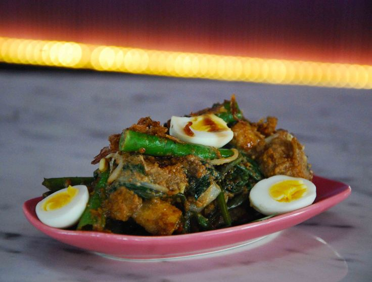 """Gado-Gado"" Vegetable Salad with Quails egg in Spicy Peanut Sauce, topped with Sweet Soy"