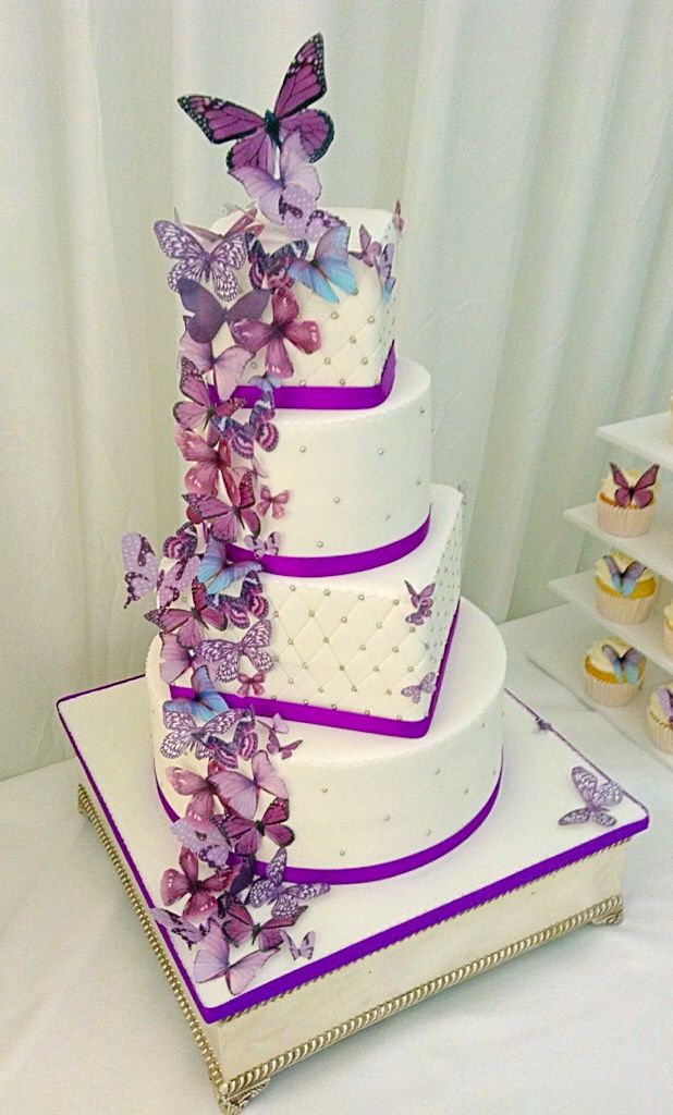 4 tier offset round and square wedding cake with beautiful butterflies and sparkling diamanté