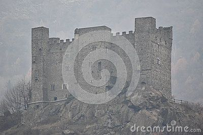 Standing on a marked, rocky promontory, Ussel castle overlooks the south side of the residential area of Chatillon, Aosta Valley in Italy Built by Ebalo II of Challant in the mid 14th century