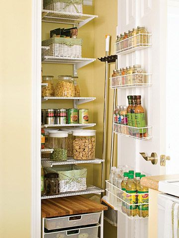 Pantry with Moveable Storage:  A pantry closet maximizes space with storage on the door as well as on a rolling cart inside. The shelves stop short of one wall, leaving space to hang a mop and broom.