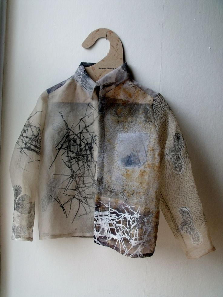 Child's Shirt,a piece considering what will remain if we do not take care of our planet,thorns but no roses,feathers but no birds, only leaf skeletons and cracked earth