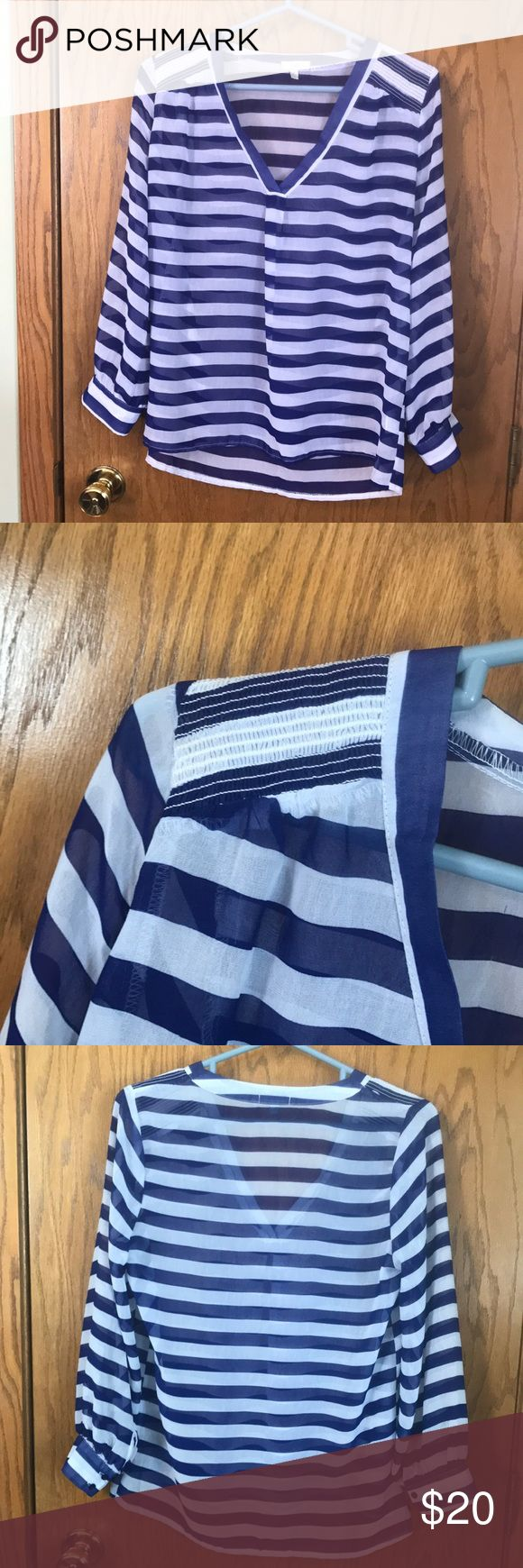 Royal blue and white blouse Blue and white v-neck striped blouse. Super cute layered over a white cami. Fate Tops Blouses