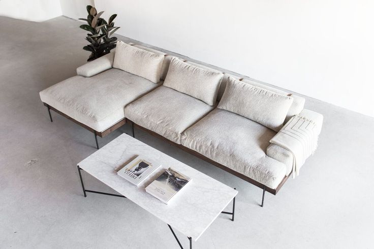 This Sectionalis Custom Made in Los Angeles. The wood frame is cut to size and joined. The upholstery is cut and sewn to shape of individual cushion. Indu
