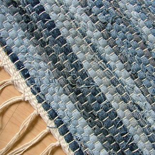 The jeans are cut apart and into strips using scissors and a manual strip cutter; then the strips are sewn together using a treadle sewing machine. They are then hand-woven on a handmade antique loom.