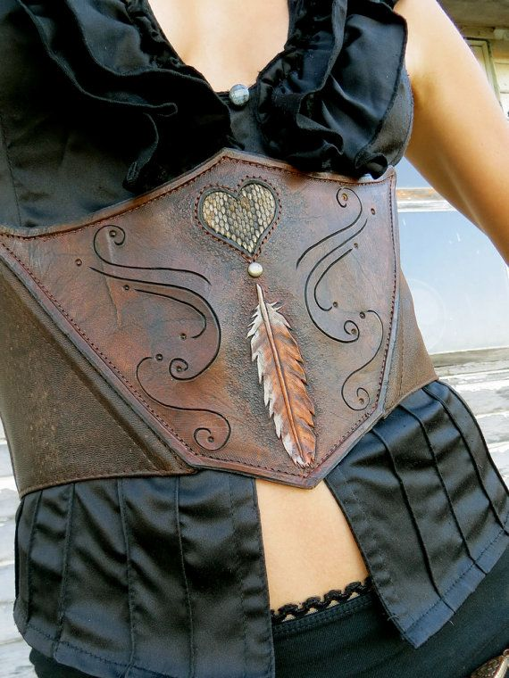 Leather waist cincher/corset. Feather and rattle snake inlay heart design. Handmade. Azrael's Circus designs. https://www.facebook.com/azraelscircus