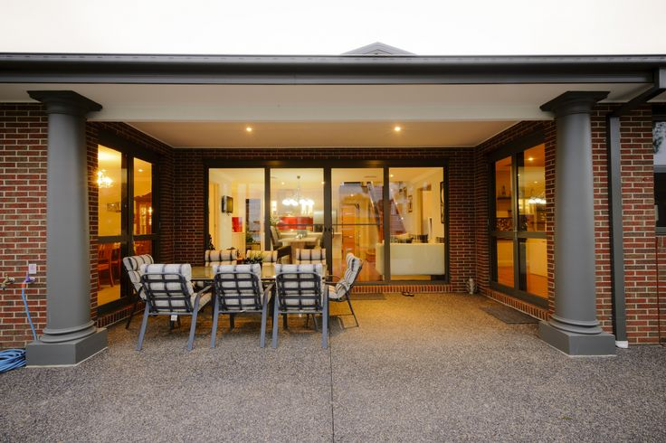 The Range - Custom Designed by Busby Homes. Alfresco area with aluminium bi-parting doors from the indoor dining area.