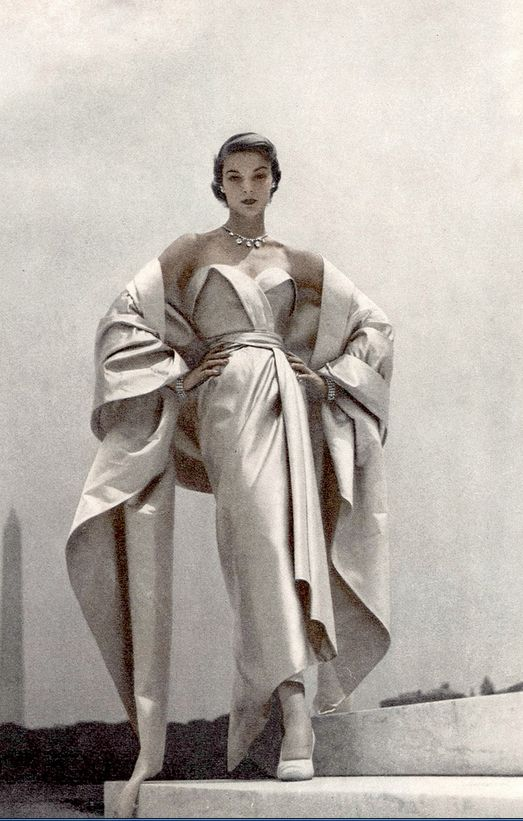 Jean Patchett in Christian Dior's blue and white satin evening gown and stole, photo by Toni Frissell, Vogue1951
