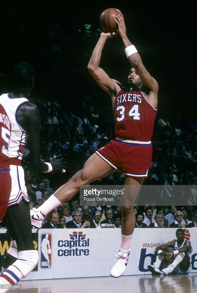 BALTIMORE, MD - CIRCA 1980's: Charles Barkley #34 of the Philadelphia 76ers in action shoots over Manute Bol #10 of the Washington Bullets during a mid circa 1980's NBA basketball game at the Baltimore Arena in Baltimore, Maryland. Barkley played for the 76ers from 1984-92.