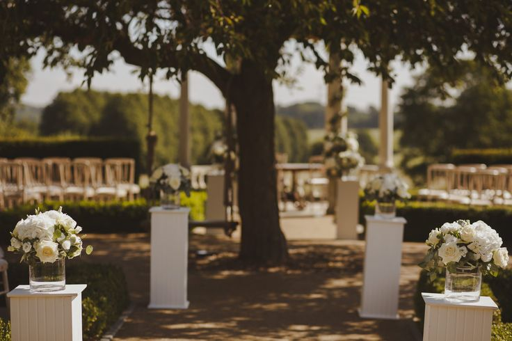 Aisle Decoration of white Hydrangea, ivory Roses and ivory Lisianthus with pastel Eucalyptus foliage at Froyle Park by Fiona Curry Flowers. Picture Motiejus