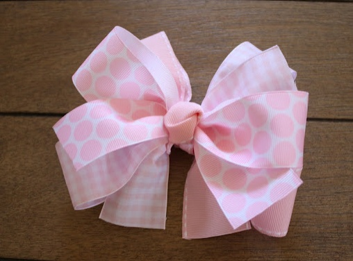 How to Make a Bow out of Ribbon- lots of other beautiful bows at this site.