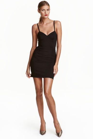 Платье-бюстье: Облегающее платье из плотного трикотажа. Без рукавов, на узких…