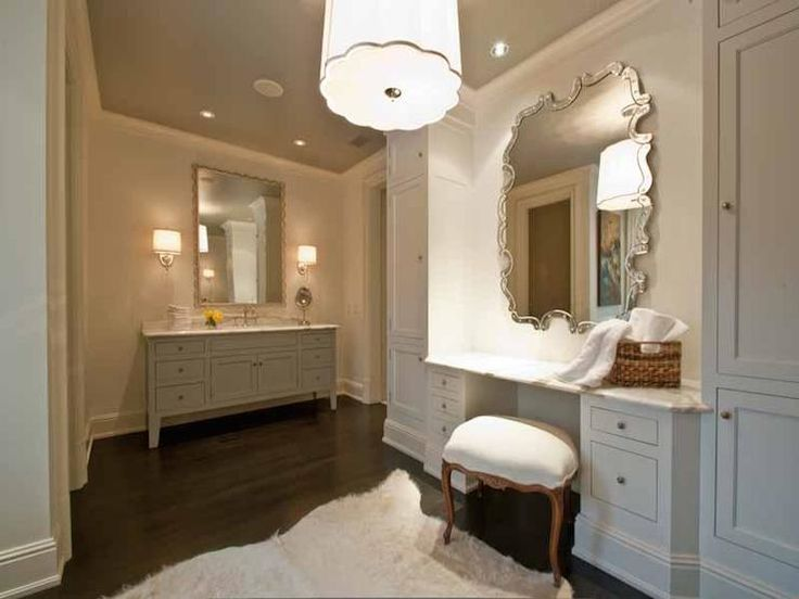 Photo Gallery In Website Elegant bathroom featuring a gray vanity with legs accented with nickel pulls and a white marble counter below a silver framed mirror flanked by nickel wall
