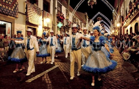 The Sanjoaninas, a festival dedicated to Saint John, the locals fill the streets of Angra do Heroísmo for ten solid days during the month of June. There are parades, concerts, bullfighting (in areas or bullfighting on a rope), food stalls, theatrical shows, fireworks and sporting events ending with a parade of popular dances. Azores, Portugal