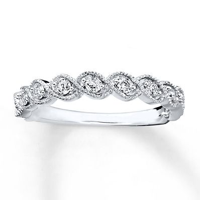 Twists of 10K white gold with milgrain detailing are highlighted with twinkling round diamonds in this beautiful band for her. Perfect as a wedding or anniversary band, the ring has a total diamond weight of 1/3 carat. Diamond Total Carat Weight may range from .29 - .36 carats.
