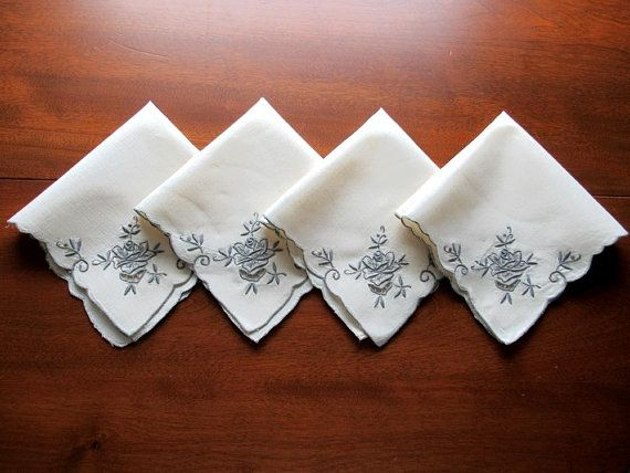 #vintagenapkins #vintagemadeira #setofnapkins   Here is a set of 4 creamy ivory linen napkins with fine hand embroidery in deep gray color used for the decorative design. They are 12.5 inches square. The edges are scalloped and edge stitched in the dark gray thread, too. They look like Madeira handwork.  They are in very good vintage