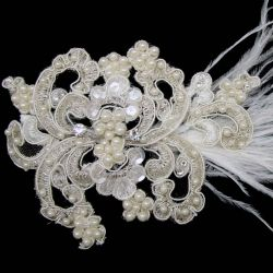 EXQUISITE HAIR PIECE  FEATURING AN INTRICATE SOFT WIRED MESH FLORAL DESIGN WITH IVORY FEATHER, CLEAR SEQUINS/CRYSTALS AND FAUX IVORY PEARLs.  CLIP ATTACHMENT FROM BEHIND.  www.weddingwonderland.com.au #wedding