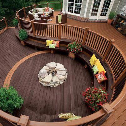 wrap-around deck area with firepit. really cool idea. This would be amazing with a pool instead of fire pit.