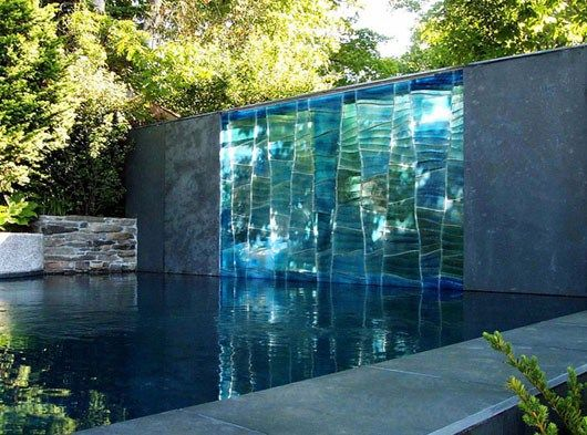 Wonderful grey/turquoise wall/mirror by a pool