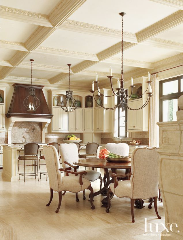 Here, a French, Neoclassical-Style residence in Dallas. Wrought-iron light fixtures lend a rustic touch to the kitchen.  See more: http://www.luxesource.com.