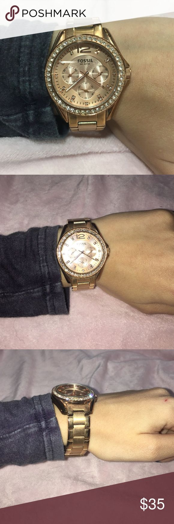 Women's Rose Gold Fossil Chronograph Watch Women's rose gold fossil chronograph watch with a crystallized bezel. Markers are also adorned with crystals. Perfect piece if you are looking for a rose gold watch. Fossil Accessories Watches