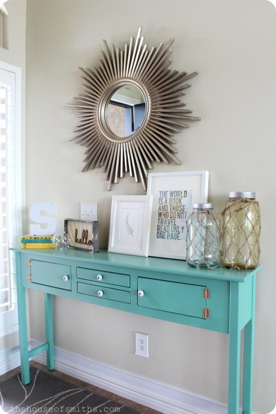 Entryway Table Decor: Place a decorative mirror the bright painted table along the entryway. Simple!...