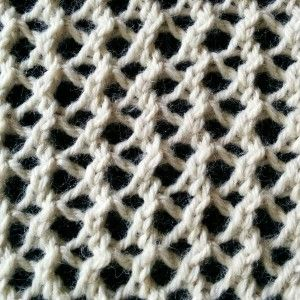 The Mesh Lace stitch is a simple lace stitch that is very easy to knit. It is done in a four row repeat and does not require advanced knitting techniques.
