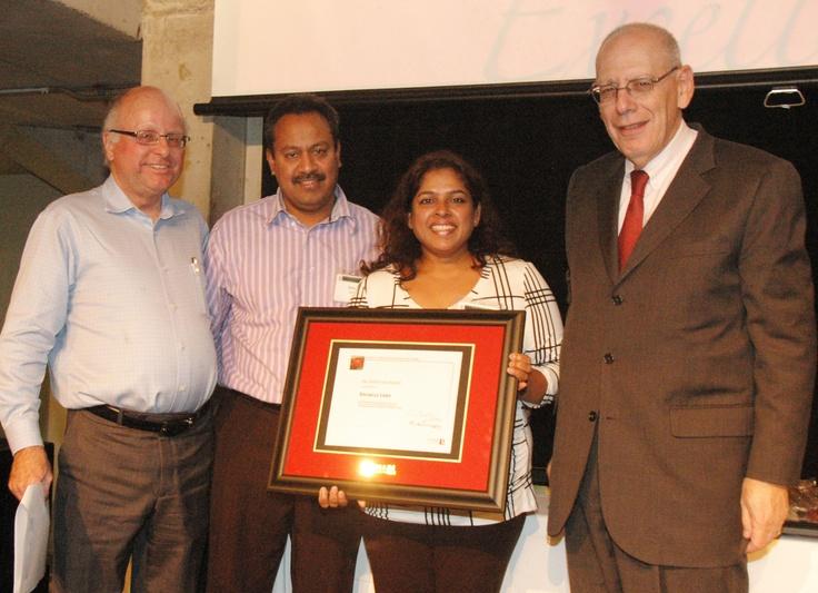 Associate Dean Gary Spraakman, left, and Dean Martin Singer, right, with the parents of Rochelle Lobo, winner of the Helen Vari Award.