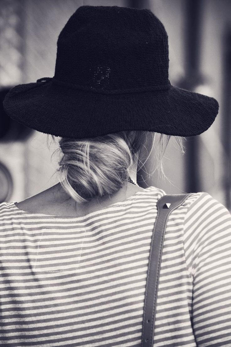 a floppy hat and a twisty bun  | out the door