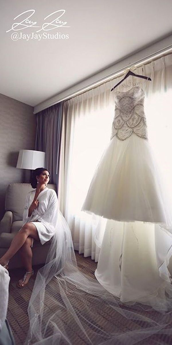 Pre-Wedding Shots: Hanging Wedding Dress ❤ See more: http://www.weddingforward.com/hanging-wedding-dress/ #weddings
