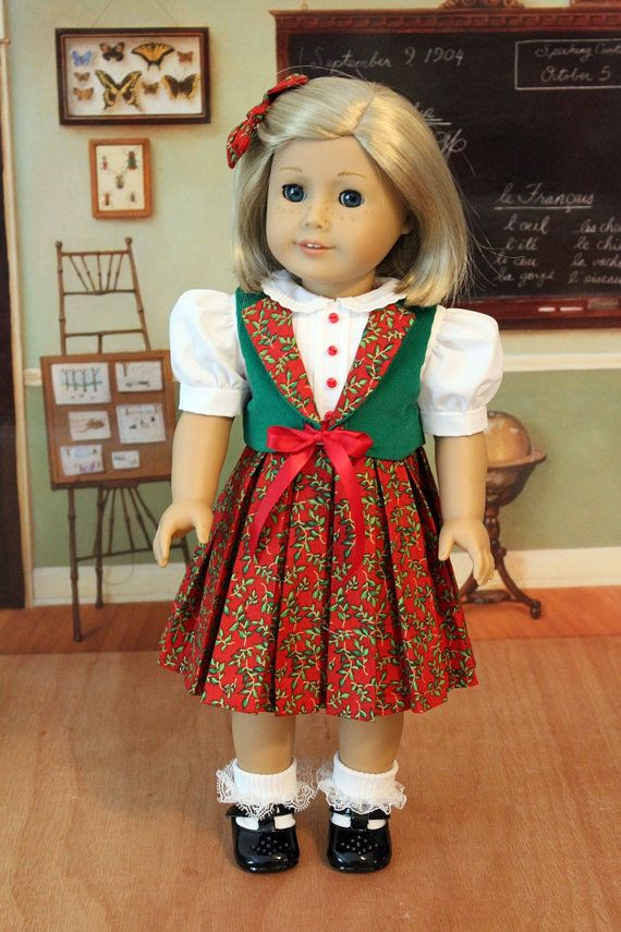 Kit is wearing her green, white and red Christmas dress. This set includes the dress, corduroy vest, and hair bow.