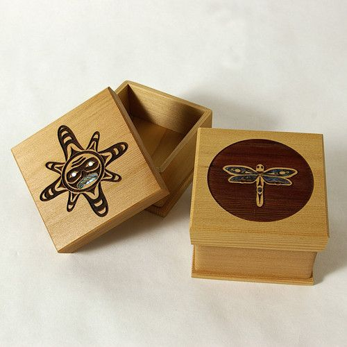 Cedar Bentwood Boxes with Abalone inlay. Designs by Spiritworks. Laser engraved with various symbols available. $45.00 CDN for small, $90.00 CDN large. Available at Northwestcoastgifts.com.