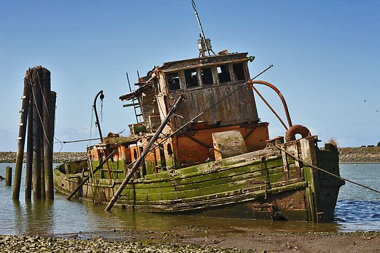 This old ship lies just off the coast in Gold Beach, Oregon.