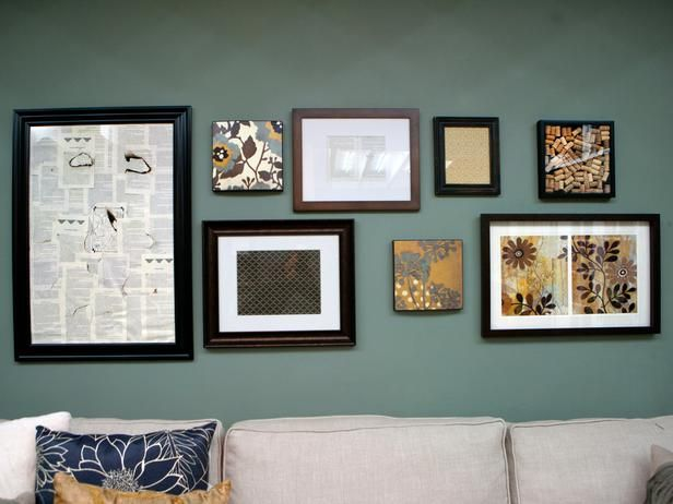 gallery wall - I like the combination of design/collectibles and picture frames